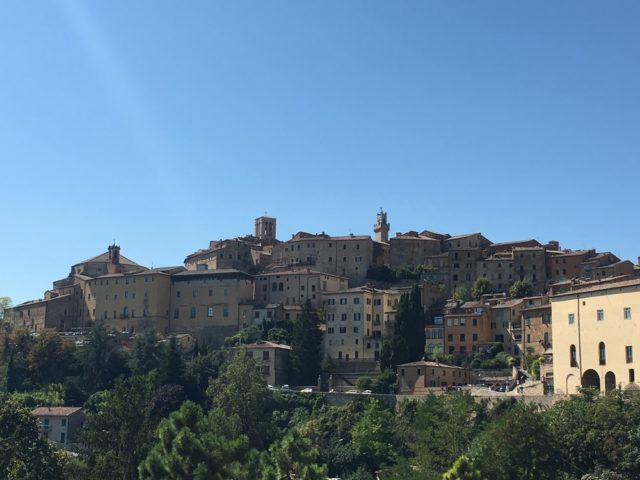 View from the historic center on the hill top and San Biagio Church at the base of hill