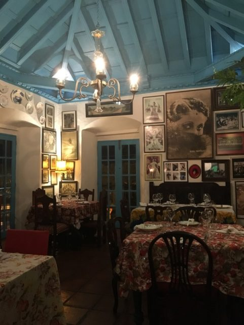 Restaurant Ivan Chef Justo. The interior walls are lined with historical photos and various ceramics
